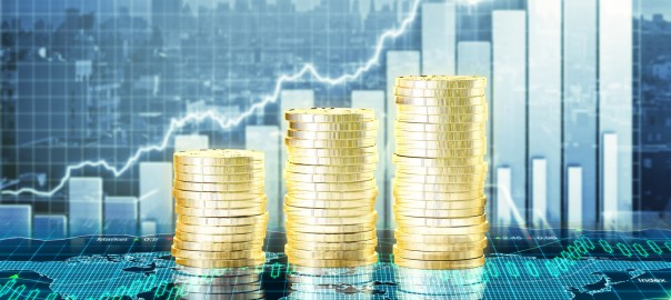 Capital growth concept with growing gold coins and charts
