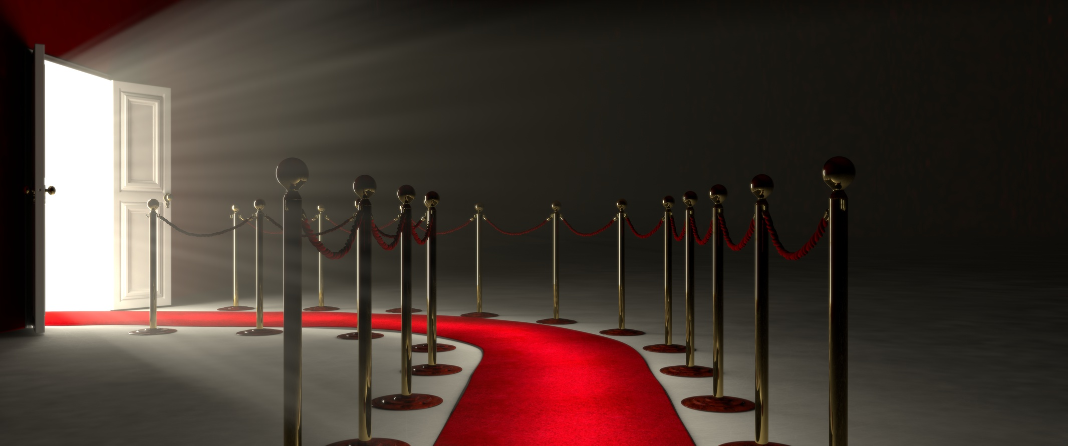 Pathway for triumph is a path delimited by an illuminated red carpet, red velvet rope  barrier and golden supports. The footpath starts in front of you and leads you to a white open door. Beyond the glorious door there is a white illuminated environment that projects its light inside the empty space. The room where I took the image consists in a gray pavement and a dark-red wall. On the left side of the picture there is the door that let you achieve the fame and new opportunities. The majestic door is open and it lets in a lot of light. The light and its volume illuminate the empty room.
