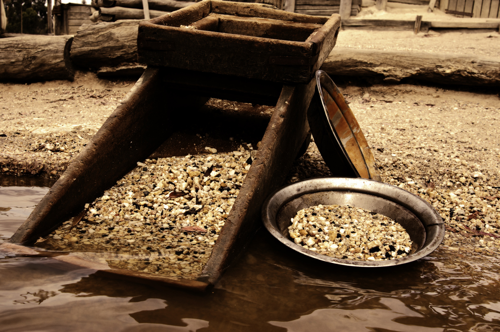 old heritage gold shaker and pan in the waters edge