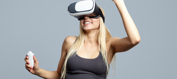 Color shot of a young woman looking through some VR glasses, a device with which one can experience virtual reality on a mobile phone.